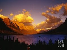 Sunrise over St. Mary Lake Photographic Print by Darrell Gulin at Art.com