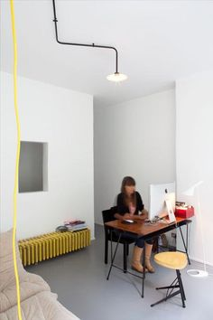 office. yellow detail. light w exposed conduit...nice detail.