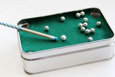 5 Coolest Altoid Tin Crafts - Ways to Use Empty Altoid Tins - Play a Game of Mini Pool - Never-ending plane rides and lunch breaks just got 10 times more fun with this pocket-size game. Sure, assembling this requires a few extra supplies—plaster, aluminum wire, felt—but needless to say the seriously awesome result is worth the effort and time. Click through redbookmag.com for more creative ideas to recycle your old Altoid tins.