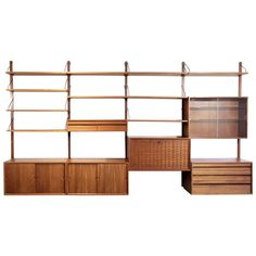 Poul Cadovius Denmark Cado Wall Unit | From a unique collection of antique and modern shelves at https://www.1stdibs.com/furniture/storage-case-pieces/shelves/