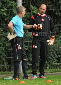 FC Twente goalkeeper Mihaylov and goaly trainer Theo Snelders