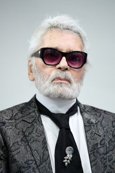 The German creative director, artist, photographer and caricaturist, Karl Lagerfeld passed away in Paris on February 19th, 2019. He was 85 years old. Karl was most well-known for his role as creative director for the French Luxury fashion house Chanel and well as the creative director for the Italian fur and leather goods fashion house, Fendi. He also had his own eponymous fashion label as well. He will be greatly missed, may he rest in peace. Karl Lagerfeld, Vogue, Fashion Labels, Fendi, Beautiful People, Luxury Fashion, Cool Style, Coco Chanel, Sunglasses