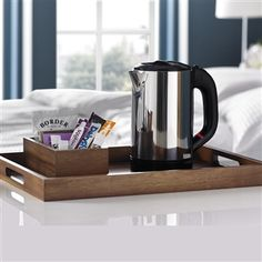 Wooden Hotel Room Tray This smart wooden tray with cut out handles is made from Acacia wood and brings a boutique hotel touch to your bedrooms. The sides are made from solid Acacia wood and the base is a water resistant coated double surface of Acacia and plywood laminate.