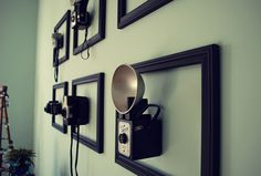 Hang empty frames, mount 3-dimensional items on the wall inside them. Alternate way to display collections (teacups, ceramic birds, idk). Mount using little clear acrylic shelves, or modified brackets/plate hangers, or...?