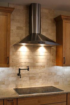 Kitchen, Stone Backsplash, Stainless Steel Range Hood, Pot Filler, Quartz Countertop, Custom Cabinets, Built by Foreman Builders.