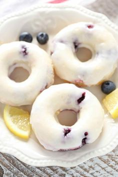Lemon blueberry donuts topped with a simple two ingredient lemon glaze. These Baked Lemon Blueberry Donuts are incredibly easy to make and perfect for breakfast! Baked Blueberry Donuts, Blueberry Juice, Baked Donuts, Blueberry Desserts, Donut Muffins, Lemon Recipes, Baking Recipes, Dessert Recipes, Yummy Recipes
