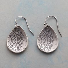"PERUVIAN PETAL EARRINGS -- A hand-carved Peruvian door inspired the etched lotus design on these sweet, sterling silver danglers. USA. Exclusive. 1-3/8""L."