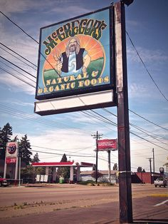 Roadside sign for McGregor's Natural & Organic Foods    8431 Pacific Ave  Tacoma, WA 98444  (253) 267-5497