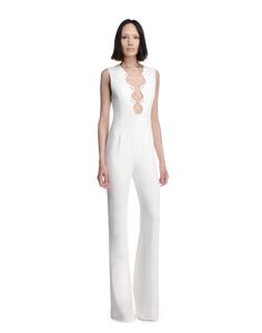 Overall - A Statement Piece. Sleeveless Jumpsuit In Cream Colored Stretch Cady Viscose. The Intricately Shaped Low Neckline Is Threaded Through With Silver Tipped Cream Laces Running Through Silver Eyelets. V Neckline At The Back. Hidden Side Zipper. Lined. Made In Italy. The Model Is 5'9