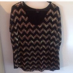 Gorgeous Torrid Short Sleeve Sequin Top Sz 2 18/20 Torrid brand sequin short sleeve tshirt top. Pair with a skirt or leggings and look fabulous. Worn a handful of times and is in flawless condition. Torrid size 2 which fits size 18/20. torrid Tops Tees - Short Sleeve