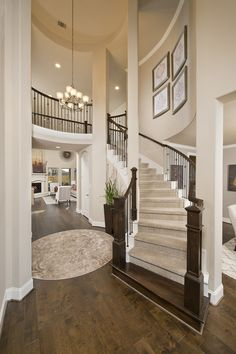 Perry Homes Grand Entrances - 4,098 Sq. Ft. #PerryHomes #trustedbuilder #homebuying #homebuilding #HoustonHomes #SanAntonioHomes #HillCountryHomes #openconcept #openfloorplan #familyhome #realestate #RelocatedtoHouston #energycorridor  #woodfloors #hardwood #foyer #entry #grandstaircase #hallway #staircase #livingspace
