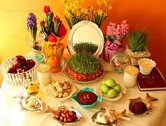 "NOWRUZ Haft Sîn (""The Seven S's"") table has seven offerings starting with S: 1. Somagh (sumac): the colour of sunrise; 2. Serkeh (vinegar): age/patience; 3. Senjed (dried fruit from lotus tree): love; 4. Samanoo (sweet pudding): affluence; 5. Sabzeh (sprouts): rebirth; 6. Sib (apple): health/beauty; 7. Sir (garlic): medicine... Also usually has Sekkeh (coin): wealth; Mahi (fish): life; Sham (candle): enlightenment; Shirini (sweets): spreading the sweetness"