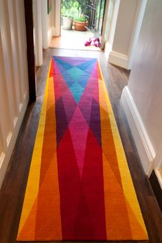 Rainbow Runner by Sonya Winner. A stunningly graphic representation of a rainbow translated into a runner.
