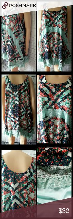 FLORAL SLEEVELESS TOP NWOT this brand new top with built-in slip will sure be hit with the you friends with the patterns and ruffles and everything sweet about this top as with some items bought from a boutique they arrive with or without tags and this is one of the items that arrived without the tags boutique  Tops
