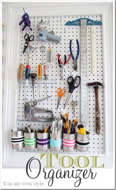 tool organizer (and she used nail polish to make the tips of the tool holders/pegs pink and green!)