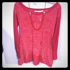 Athleta red long sleeve shirt Athleta red long sleeved shirt, with elegant design on a lighter overlay. Light weight material, with beautiful lace up backside. Great condition, only worn once. Athleta Tops Tees - Long Sleeve
