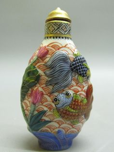 Chinese Porcelain Carved Fish Pattern Snuff Bottle