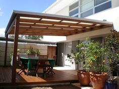 by Pitched Pergolas & DeckStyle