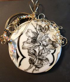 Pen work on porcelain by Alicia Weston Spears.