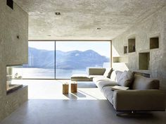House+in+Brissago+Wespi+de+Meuron+Romeo+architects modern concrete living room with a view