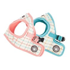 The Puppia Tot Vest Harness is a jacket style dog harness available in peach or aqua colors sweetly designed with a checkered pattern and Puppia's rubber paw print label. It is made of 100% natural cotton making it soft and comfortable for pets while walk