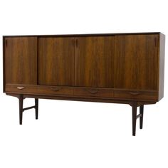 Stunning Danish Mid-Century Modern Highboard or Sideboard, 1960s | From a unique collection of antique and modern sideboards at https://www.1stdibs.com/furniture/storage-case-pieces/sideboards/