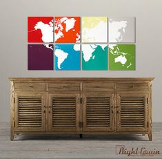 World map multi-canvas wall art. I love the idea of having each canvas a different color! I'm a huge fan of rainbows and maps, making this an amazing combination. You could easily paint the backgrounds the same color though, for a different look.