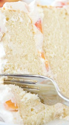 Vanilla Peach Layer Cake ~ Tender, moist cake is layered with a sweet peaches and cream frosting, with chunks of fresh peaches.