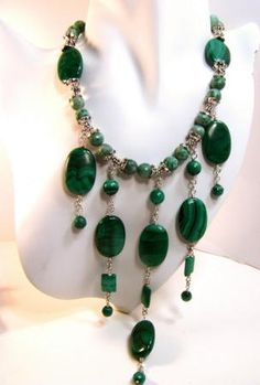 This stylish bead necklace is handcrafted of genuine, natural Malachite stones. Sterling Silver and Tree agate beads enhance the design.  Sterling Silver Lobster clasp for secure closer.