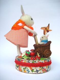 Delightful pom pom and needle felted bunnies.