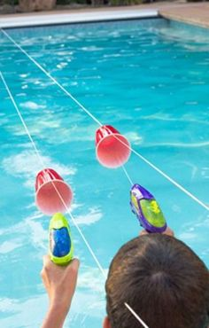 15 Fun Swimming Pool Games For You and Your Family Squirt Gun Races: This elab. 15 Fun Swimming Pool Games For You and Your Family Squirt Gun Races: This elaborate obstacle cour Pool Party Games, Pool Party Kids, Outdoor Party Games, Outdoor Games For Kids, Kid Pool, Fun Games, Pool Party Activities, Pool Fun, Indoor Games