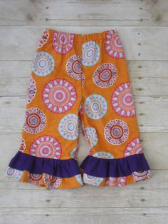 Ruffles Galore Boutique Girls Pants--Orange medallions and purple ruffle --Sizes 3 months-10 years