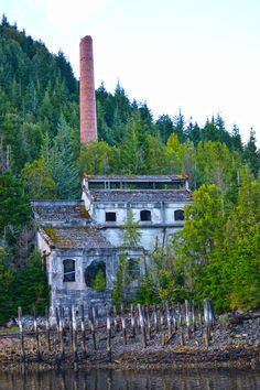 The old coke plant at Anyox, BC. The place is now a ghost town and abandoned. Smoke stack made of bricks with pilings in front. Abandoned Mansions, Abandoned Places, N America, Adventure Tours, Ghost Towns, Historical Photos, British Columbia, Urban Decay, Places To Visit