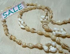 ON SALE Necklace Strand Small Tiny Shells Natural by AtticBasement