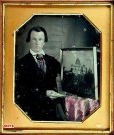 ca. 1850, [daguerreotype portrait of an artist posed holding stylus with a framed painting or drawing of a domed building, possibly a state capital] via the Daguerreian Society, Julian Wolff Collection