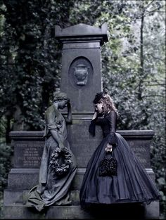 A neo-Victorian goth lady posing with a memorial. #goth #fashion #graveyard
