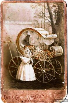 Infant perambulator, color tinted, circa 1900, studio photograph