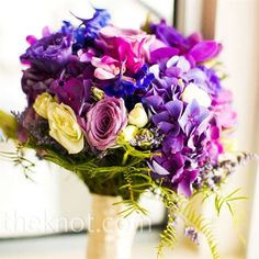 """Nicole's bouquet was a purple-lover's dream -- literally. """"It was exactly what I had envisioned,"""" says the bride. The textural mix included hydrangeas, orchids, lisianthus, roses, and lavender."""