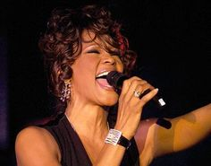 Whitney Houston has taken another step on the comeback trail, giving her first UK performance in years at a charity event organised by a mobile phone mogul.    The music diva, treated guests at the Caudwell Children's Ball to a greatest hits package including her most famous track, I Will Always Love You.