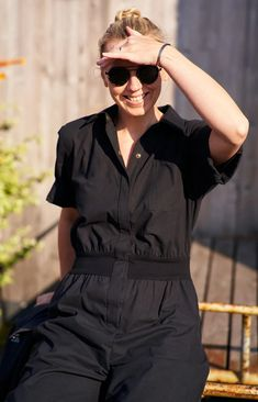 Button up jumpsuit coal black. Designed for passionate home cooks and the ones enjoying comfort and style. Sustainable design: made from repurposed Finnish rental textiles. Sustainable Design, Inside Out, Repurposed, Jumpsuit, Textiles, Legs, Button, People, How To Wear