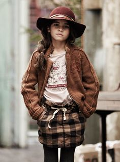 Why do I like the style of little children? But, chunky cardigan with plaid skirt and hat could look alright on an adult, I dunno.