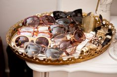 Mirrored vanity tray as a catch-all for sunglasses and jewelry #closet #dressing_room #accessories #organization #storage