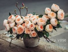 Peach Poise Classic beauty meets contemporary floral design with this timeless piece. Voluminous roses in a soft, pastel peach show off their delicately ruffled petals against a backdrop of lush gardenia leaves. Stems of rose buds add an organic touch.