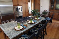 #Kitchen Idea of the Day: Classic golden-brown kitchen with a BEAUTIFUL granite island countertop.