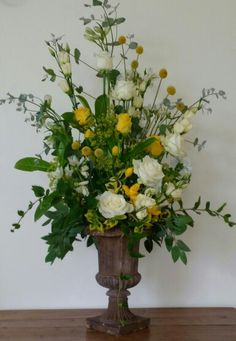 Yellow, white & cream display in distressed Teracotta Urn