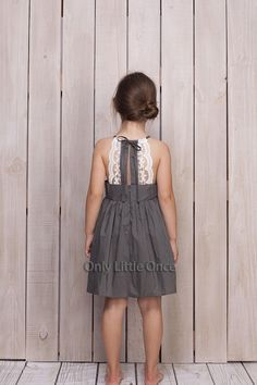 This stunning sun dress is perfect for warmer days! A subtle gray color is dressed up with delicate white lace! The cut out lace back is absolutely stunning and unique. This is a serious head turner that will leave your little one the best dressed at any event. Easy to care for woven