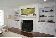 White painted firesurround with built ins.