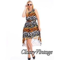 NWT lined chiffon dress. Beautiful animal print dress. This is size 1X . Lined chiffon dress with elastic waist and faux drawstring detail at waist. Made in USA and run true to size. Maddie Dresses