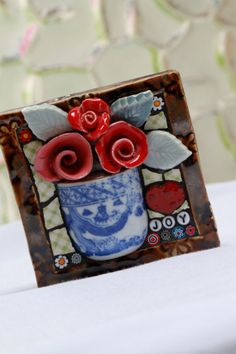 I love teacups! What a cute way to use them.... Now, where do I get the porcelain roses??? Roses Joy Mosaic art mixed media mosaic by Lisabetzmosaicart, $48.00