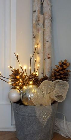 Cute on the front porch, but I'd probably spay paint the bucket gold with glitter! Cause that's the way I roll. LOL  Great elements for simple DIY Christmas decor.